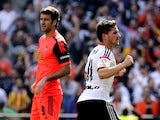 Valencia's Argentinian forward Pablo Piatti celebrates his goal next to Real Sociedad's forward Imanol Agirretxe during the Spanish league football match Valencia CF vs Real Sociedad de Futbol at the Mestalla stadium in Valencia on March 1, 2015