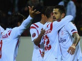 Vitolo of Sevilla (R) celebrates with team mates as he scores their second goal during the UEFA Europa League Round of 32 second leg match against Moenchengladbach on February 26, 2015