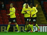 Odion Ighalo of Watford (24) celebrates with Troy Deeney (9) and Almen Abdi (22) as he scores their first goal during the Sky Bet Championship match between Watford and Rotherham United at Vicarage Road on February 24, 2015