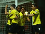 Troy Deeney of Watford celebrates with team mates as he scores their second goal during the Sky Bet Championship match between Watford and Rotherham United at Vicarage Road on February 24, 2015