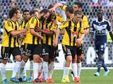 Rolieny Bonevacia of the Phoenix is congratulated by team mates after scoring a goal during the round 19 A-League match between the Melbourne Victory and the Wellington Phoenix at AAMI Park on March 1, 2015