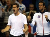 Britain's Andy Murray (L) and James Ward cheer as their teammates Britain's Dominic Inglot and Jamie Murray compete against Mike Bryan and Bob Bryan of US (not pictured) during the Davis Cup match on March 7, 2015
