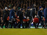 Bafetibis Gomis of Swansea City is stretchered off during the Barclays Premier League match between Tottenham Hotspur and Swansea City at White Hart Lane on March 4, 2015