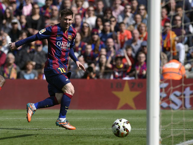 Barcelona's Argentinian forward Lionel Messi scores a goal during the Spanish league football match FC Barcelona vs Rayo Vallecano de Madrid at the Camp Nou stadium in Barcelona on March 8, 2015