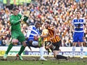 Yakubu Aiyegbeni of Reading is closed down by goalkeeper Ben Williams of Bradford City and Rory McArdle of Bradford City during the FA Cup Quarter Final match between Bradford City and Reading at the Coral Windows Stadium, Valley Parade on March 7, 2015