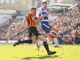 Stephen Darby of Bradford City takes a shot on goal under pressure from Oliver Norwood of Reading during the FA Cup Quarter Final match between Bradford City and Reading at the Coral Windows Stadium, Valley Parade on March 7, 2015