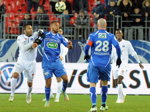 Brest's forward Youssef Adnane vies with Auxerre's midfielder Remi Mulumba (2-L) during the French Cup football match between Brest and Auxerre on March 5, 2015