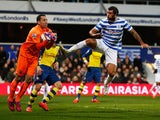 Charlie Austin of QPR challenges goalkeeper David Ospina of Arsenal during the Barclays Premier League match on March 4, 2015
