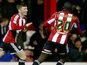 Chris Long of Brentford celebrates his goal during the Sky Bet Championship match between Brentford and Huddersfield Town at Griffin Park on March 3, 2015