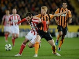 Danny Graham of Sunderland and Paul McShane of Hull City compete for the ball during the Barclays Premier League match on March 3, 2015