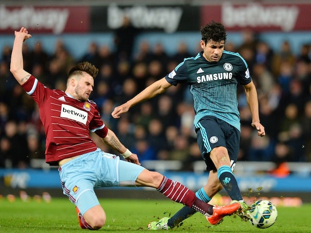 Chelsea's Brazilian-born Spanish striker Diego Costa (R) has an unsuccessful shot under pressure from West Ham United's English defender Carl Jenkinson on March 3, 2015