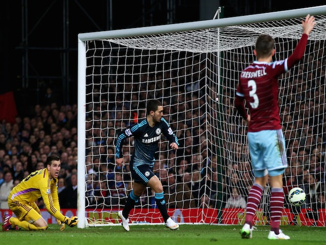 Eden Hazard of Chelsea turns away to celebrate after scoring the opening goal during the Barclays Premier League match against West Ham on March 4, 2015