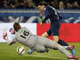 Paris Saint-Germain's Uruguayan forward Edinson Cavani (R) scores his team's second goal during the French Cup football match against Monaco on March 4, 2015