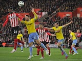 Southampton's Dutch midfielder Eljero Elia (L) flicks the ball on during the English Premier League football match against Crystal Palace on March 3, 2015