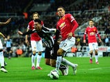 Manchester United player Chris Smalling (r) challenges Emmanuel Riviere of Newcastle in the penalty area during the Barclays Premier League match
