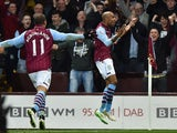 Aston Villa midfielder Fabian Delph celebrates scoring the opening goal during the FA Cup quarter-final against West Bromwich Albion at Villa Park on March 7, 2015