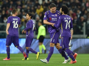 Mohamed Salah (R) of ACF Fiorentina celebrates the opening goal with team mate Mario Gomez during the TIM Cup match between Juventus FC and ACF Fiorentina at Juventus Arena on March 5, 2015