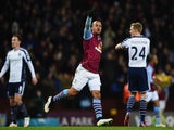 Gabriel Agbonlahor of Aston Villa celebrates scoring the opening goal during the Barclays Premier League match against West Bromwich Albion on March 3, 2015