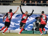 Guingamp's French forward Christophe Mandanne celebrates after scoring a goal during the French Cup football match between Concarneau and Guingamp on March 5, 2015