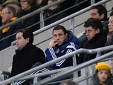 Sunderland's Uruguayan manager Gus Poyet (C) watches from the stands during the English Premier League football match against Hull City on March 3, 2015