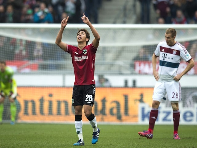 Hannover's Japanese midfielder Hiroshi Kiyotake celebrates scoring the opening goal during the German first division Bundesliga football match against Bayern Munich on March 7, 2015