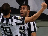 Juventus' Argentine forward Carlos Tevez celebrates after scoring a goal during the Italian Serie A football match between AS Roma and Juventus at the Olympic Stadium in Rome on March 2, 2015