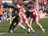 Ken Pisi of Northampton is knocked into touch by Jonny May during the Aviva Premiership match between Gloucester and Northampton Saints at Kingsholm Stadium on March 7, 2015