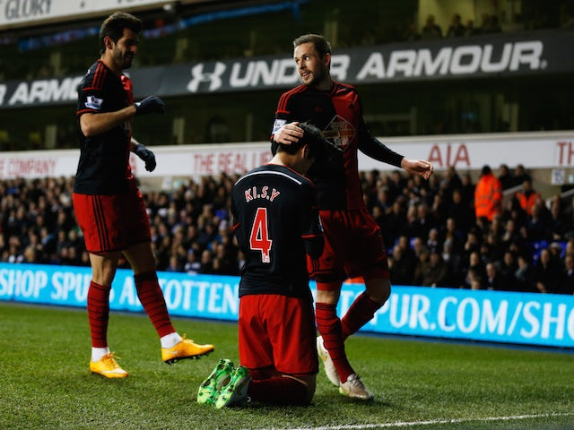 Ki Sung-Yueng of Swansea City (4) celebrates with team mates as he scores their first and equalising goal during the Barclays Premier League match against Tottenham Hotspur on March 4, 2015
