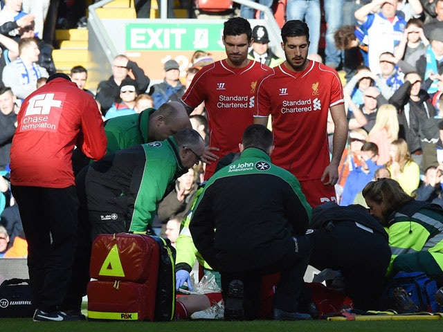 Liverpool's Slovakian defender Martin Skrtel is treated after a challenge with Blackburn's French-born Beninese striker Rudy Gestede during FA Cup quarter-final match between Liverpool and Blackburn Rovers at Anfield in Liverpool, north west England on Ma