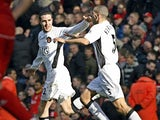 Manchester United's John O'Shea celebrates scoring with Rio Ferdinand during their English Premiership football match against Liverpool at Anfield , Liverpool , north-west England, 03 March 2007