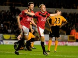 Paul Scholes of Manchester United celebrates his goal during the Barclays Premier League match between Wolverhampton Wanderers and Manchester United at Molineux on March 6, 2010