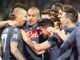 Napoli's Slovak forward Marek Hamsik (L) celebrates with teammates after scoring during the Italian Serie A football match SSC Napoli vs FC Internazionale Milano on March 08, 2015