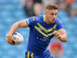 Matthew Russell of Warrington Wolves in action during the Super League match between Warrington Wolves and St Helens at Etihad Stadium on May 18, 2014