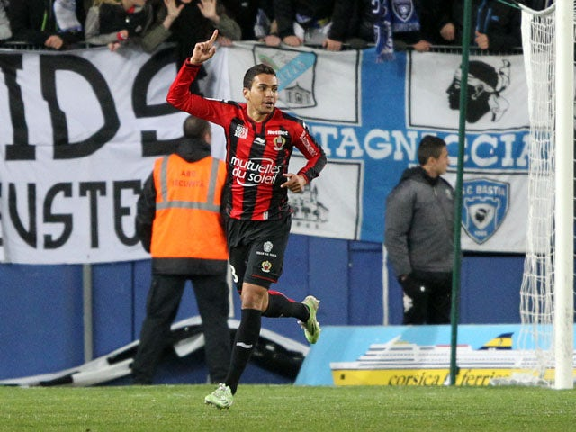 Nice's Brazilian midfielder Carlos De Olivera Alves celebrates after scoring a goal during a French L1 football match Bastia (SCB) against Nice (OGCN) at the Armand Cesari stadium in Bastia on March 7, 2015