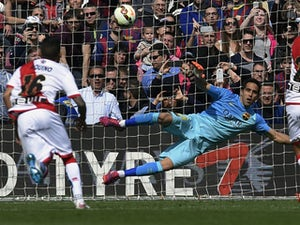 Rayo Vallecano's Bueno scores during the Spanish league football match FC Barcelona vs Rayo Vallecano de Madrid at the Camp Nou stadium in Barcelona on March 8, 2015