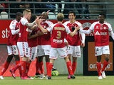 Reims' teammates celebrate after Reims' French Algerian defender Aissa Mandi scored a goal during the French Football match Reims vs Nantes, on March 7, 2015
