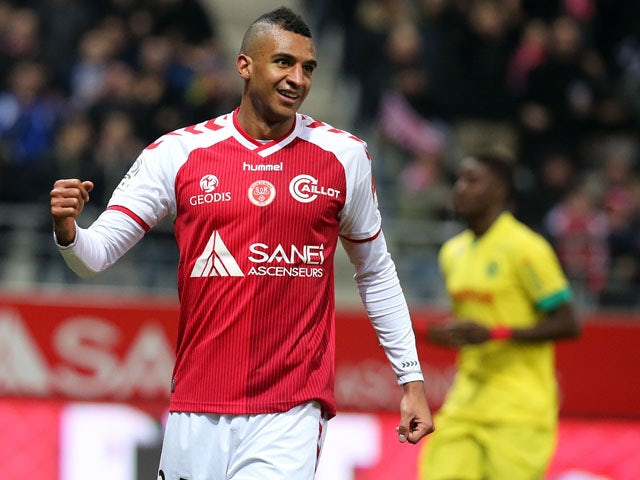 Reims' French forward David Ngog celebrates after scoring a goal during the French Football match Reims vs Nantes, on March 7, 2015
