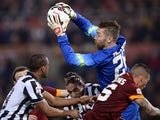 Roma's goalkeeper Morgan De Sanctis makes a save during the italian Serie A football match Roma vs Juventus at the Olympic Stadium in Rome on March 2, 2015