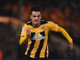 Ryan Donaldson of Cambridge United runs with the ball during the FA Cup Fourth Round match between Cambridge United and Manchester United at The R Costings Abbey Stadium on January 23, 2015