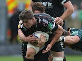 Sam Lewis of the Ospreys is tackled during the Heineken Cup pool 1 match between Northampton Saints and Ospreys at Franklin's Gardens on October 20, 2013