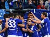 Schalke's players celebrate scoring during the German first division Bundesliga football match FC Schalke 04 v 1899 Hoffenheim in Gelsenkirchen, Germany, on March 7, 2015