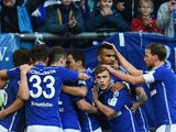 Schalke's players celebrate scoring during the German first division Bundesliga football match FC Schalke 04 v 1899 Hoffenheim in Gelsenkirchen, Germany, on March 7, 2015