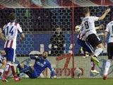 Valencia's German defender Shkodran Mustafi (R) heads a ball and scores during the Spanish league football match against Atletico Madrid on March 8, 2015