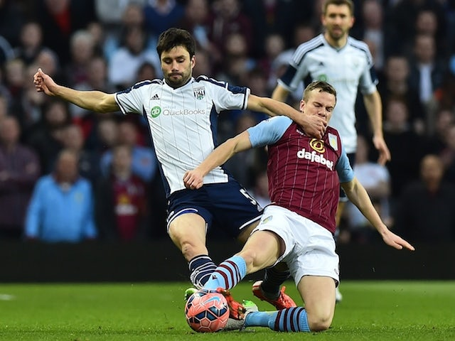 Aston Villa's English midfielder Tom Cleverley (R) vies with West Bromwich Albion's Argentinian midfielder Claudio Yacob during the FA Cup quarter-final match  on March 7, 2015