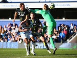 Harry Kane of Spurs beats Robert Green of QPR to score their first goal with a header during the Barclays Premier League match between Queens Park Rangers and Tottenham Hotspur at Loftus Road on March 7, 2015