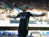 Harry Kane of Spurs celebrates as he scores their second goal during the Barclays Premier League match between Queens Park Rangers and Tottenham Hotspur at Loftus Road on March 7, 2015