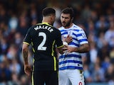 Kyle Walker of Spurs and Charlie Austin of QPR argue during the Barclays Premier League match between Queens Park Rangers and Tottenham Hotspur at Loftus Road on March 7, 2015