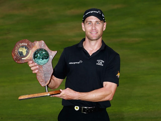 Trevor Fisher Jnr of South Africa poses with the trophy after winning the Africa Open at East London Golf Club on March 8, 2015