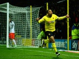 Troy Deeney of Watford celebrates scoring the first goal during the Sky Bet Championship match between Watford and Fulham at Vicarage Road on March 3, 2015
