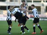 Molla Wague #2 of Udinese Calcio is mobbed by team mates after scoring his team's third goal during the Serie A match between Udinese Calcio and Torino FC at Stadio Friuli on March 8, 2015